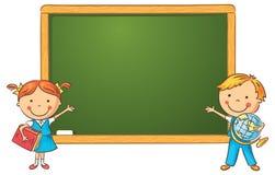 Kreskówka ucznie przy Blackboard Zdjęcie Stock