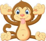 Kreskówki małpa robi twarzy i pokazuje jego jęzor Fotografia Stock