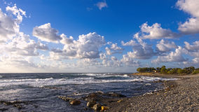 kreta Wolken en golven Stock Foto