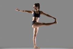 Kretsad hand till stora Toe Yoga Pose Royaltyfria Bilder