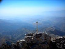 Kreuz auf der Alpe Stockfotografie