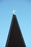 Kreuz auf einem Dach Stockbilder