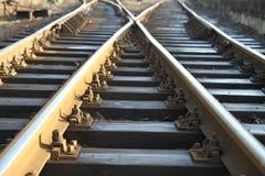 Kreuz auf Schienenstrang Stockfotografie