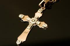 Kreuz des Goldes und des Platins Stockfoto