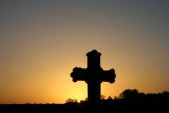 Kreuz im Sonnenaufgang Lizenzfreie Stockfotos