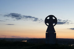 Kreuz am Sonnenuntergang Lizenzfreie Stockfotos