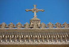 Kreuz und Dekoration. Stockfotografie