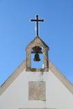 Kreuz und Glocke Stockbilder