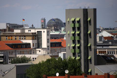 Kreuzberg tower. CIRCA MAY 2014 - BERLIN: aerial view: in the foreground the Kreuzberg Tower appartement building (by John Hejduk), in the background the dome of Stock Image