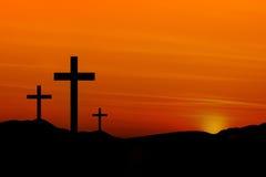 Kreuze im Sonnenuntergang Stockfotos