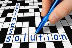 Kreuzworträtsel - Geschäft und Lösung Stockfotos
