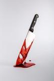 Krew wymokły Kuchenny nóż w morzu krwi Fotografia Stock