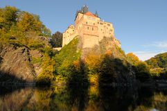 Kriebstein castle Saxony Germany. Kriebstein castle in late afternoon reflected in a lake; Saxony, Germany Stock Photography