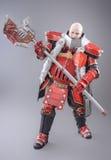 Krieger in der Rüstung mit Axt Stockbild