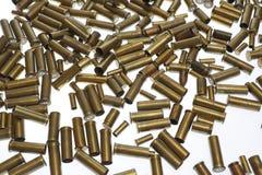 Kriegsymbole. Benutzte leere alte Gewehrkugelkassetten Lizenzfreies Stockbild