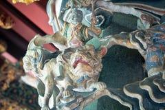 Krigaregud som snider på yttersidan av en tempel Royaltyfria Foton