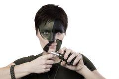 Krigkvinna med vapnet Royaltyfria Bilder