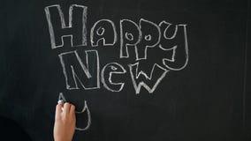Krijt die Gelukkig Nieuwjaar trekken stock footage