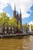 Krijtberg Kerk Roman Catholic church at the Singel canal. Amsterdam, Netherlands. Royalty Free Stock Images