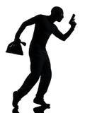 Krimineller Terrorist des Diebes, der Gewehrmann zielt lizenzfreie stockfotografie