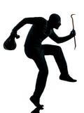 Krimineller Terrorist des Diebes, der Gewehrmann zielt Stockbild