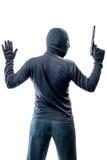 Krimineller Terrorist mit den Händen oben lokalisiert auf Weiß stockfoto