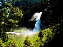 Krimml vattenfall i österrikiska fjällängar Arkivbild
