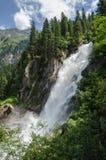 Krimml waterfalls in the Alpine forest, Austria stock photo