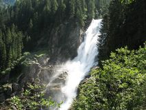 Krimml Waterfalls. Are the fifth highest waterfalls in the world and it drops of 380 m.A hiking trail makes it possible to get very close to this breathtaking Stock Image