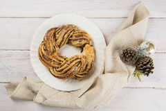 Kringle stonian for christmas. Kringle or pretzel, traditional Christmas dessert in Northen Europe with cinnamon and walnuts stock photography
