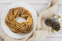 Kringle stonian for christmas. Kringle or pretzel, traditional Christmas dessert in Northen Europe with cinnamon and walnuts royalty free stock photos