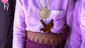 Kris and pendant. Became a symbol of Malay traditional bride dresses Stock Image