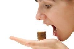 Krisenkonzept - Essen Ihres Geldes Stockfotografie