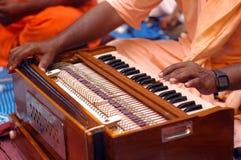 Krishna Devotee Playing Harmonium. Hare Krishna devotees playing harmonium during music festival stock photo
