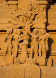Krishna flees angry, naked women statue. Stock Photography