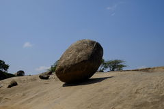 Krishna rock. Standing on small slope in Mahabalipuram, Tamil Nadu Stock Photos