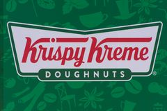 Krispy Kreme Doughnuts Sign with green background stock images