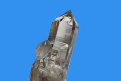 Kristal op blauwe achtergrond stock foto's