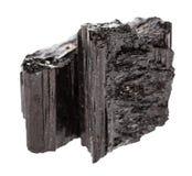 Kristallen av den svarta tourmalinen Schorl isolerade Arkivbilder