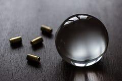 Kristallen bol met munitie-dark Stock Afbeeldingen