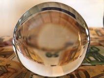 Kristallkula och stora valöreurosedlar royaltyfri fotografi