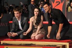 Kristen Stewart, Robert Pattinson, Taylor Lautner. Robert Pattinson (left), Kristen Stewart & Taylor Lautner at hand & footprint ceremony honoring the Twilight Royalty Free Stock Photography