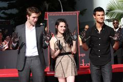 Kristen Stewart,Robert Pattinson,Taylor Lautner. Robert Pattinson, Kristen Stewart and Taylor Lautner  at the 'Twilight' Hand and Footprint Ceremony, Chinese Stock Image