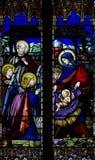 Kristi födelse (födelsen av Jesus) i målat glass royaltyfria bilder