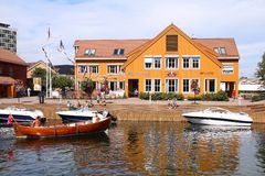 Kristiansand, Norway. AUGUST 9: People visit old town harbor on August 9, 2010 in . Kristiansand is the 5th largest municipality in Norway (90 thousand people royalty free stock photography