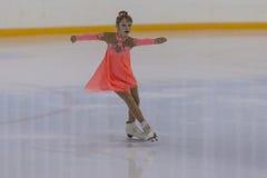 Kristina Strelkova de Russie exécute le programme de patinage gratuit de filles argentées de la classe III Images libres de droits