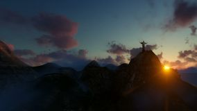 Kristus Förlossare på solnedgången, kameraflyg från Rio de Janeiro, Brasilien arkivfilmer