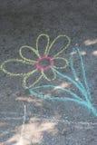 Krita för teckning för barn` s på asfalt Arkivfoto