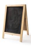 Krita gniden ut på den isolerade svart tavla Royaltyfri Foto
