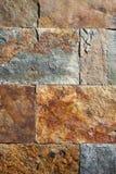 Kritisera färgrika texturtegelplattor för stenen Arkivbilder